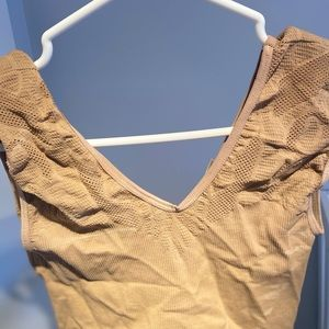 Stretchy tan cropped camisole.